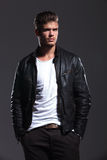 Young man in leather jacket is looking away Royalty Free Stock Photography