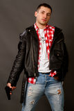 Young man in a leather jacket Royalty Free Stock Photos