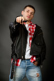 Young man in a leather jacket Stock Images