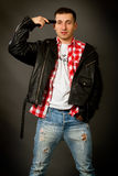 Young man in a leather jacket Royalty Free Stock Photo