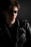A young man in leather jacket and sunglasses Royalty Free Stock Photo
