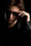 A young man in leather jacket and sunglasses Stock Photo