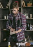 Young man leather maker packed in small cardboard box leather handmade wallet Stock Photography