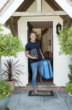 Young man leaving home Royalty Free Stock Images