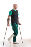 Young man with a leg cast and crutches Royalty Free Stock Photos