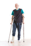 Young man with a leg cast and crutches Stock Photography