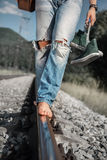 Young man legs in ripped jeans close up image Stock Image