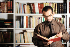 Young man  in library Royalty Free Stock Photo