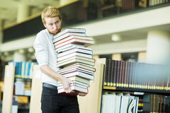 Young man in the library Stock Photo