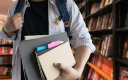 Young man In the library books high school library royalty free stock photography