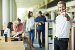 Young man in the library Stock Image
