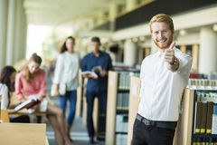 Young man in the library Royalty Free Stock Photos