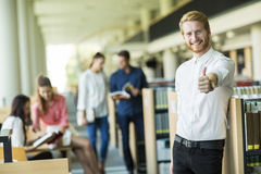 Young man in the library Royalty Free Stock Images