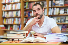Young man in the library. Young man working and thinking in the library Stock Images