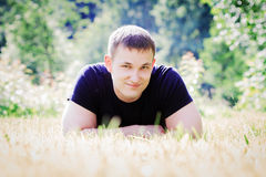 Young man lies on the grass in the park Stock Photos
