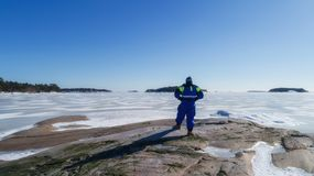 Young man life saver watching the situation on the ice royalty free stock image