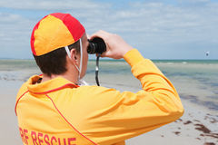 Life saver. Young man life saver watching the situation on the sea stock images