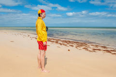 Young man  lifesaver. Watching the situation on the sea Stock Images