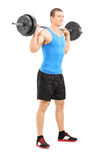 Young man lifting a barbell Stock Images