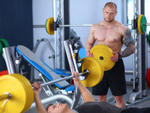 Young man lifting the barbell in gym with Royalty Free Stock Image