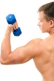 Young man lifting blue dumbbells weights by hand Royalty Free Stock Photos