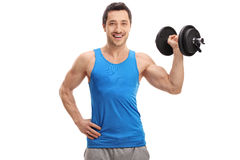 Young man lifting a dumbbell Royalty Free Stock Photography