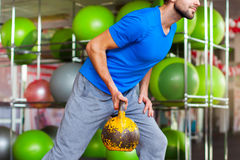 Young man lifting dumbbells at crossfit gym Stock Image