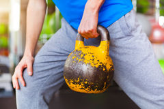 Young man lifting dumbbells at crossfit gym Royalty Free Stock Photo