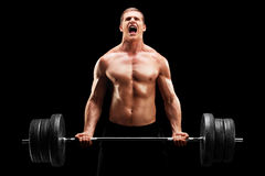 Young man lifting a heavy weight Royalty Free Stock Photography