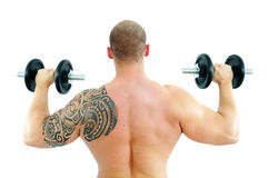 Young man lifting weight Stock Photo