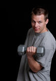 Young man lifting a weight Royalty Free Stock Image