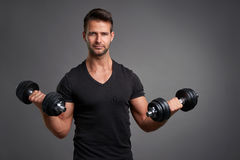 Young man lifting weight Royalty Free Stock Images