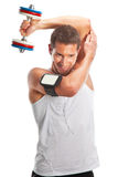 Young man lifting weight and listening to portable music Stock Photography