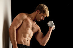 Young man lifting weights Royalty Free Stock Image
