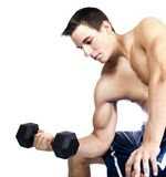 Young man lifting weights. A young man lifts weights against a white background royalty free stock photos