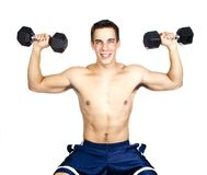 Young man lifting weights. A young man lifts weights against a white background royalty free stock images