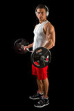 Young man lifting weights. Royalty Free Stock Photos