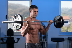 Young Man Lifting Weights With Barbell Stock Photography