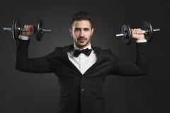 Young man lifting weights Stock Photos