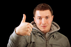 Young man lifts thumb upwards Royalty Free Stock Photos