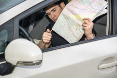 Young Man Lighting Up a Map Inside the Car Stock Photography