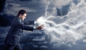 Young man with lightnings from his hands Stock Photography