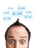 Young man with LIKE sign over his head Royalty Free Stock Photo