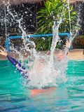 Young man , like to play in the water. royalty free stock image