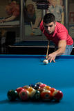 Young Man Lines Up A Shot. Young Man Lining To Hit Ball On Pool Table Stock Photos