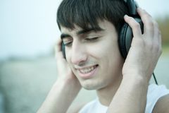 Young man listen to music Royalty Free Stock Image