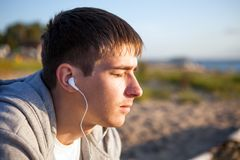 Man listen to the music. Young Man listen to the Music outdoor stock image