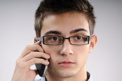 Young man listening. White, young, handsome man talking on mobile Royalty Free Stock Photos