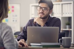 Free Young Man Listening A Client In The Office Stock Images - 107867784