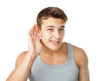 Young man listening carefully Stock Image